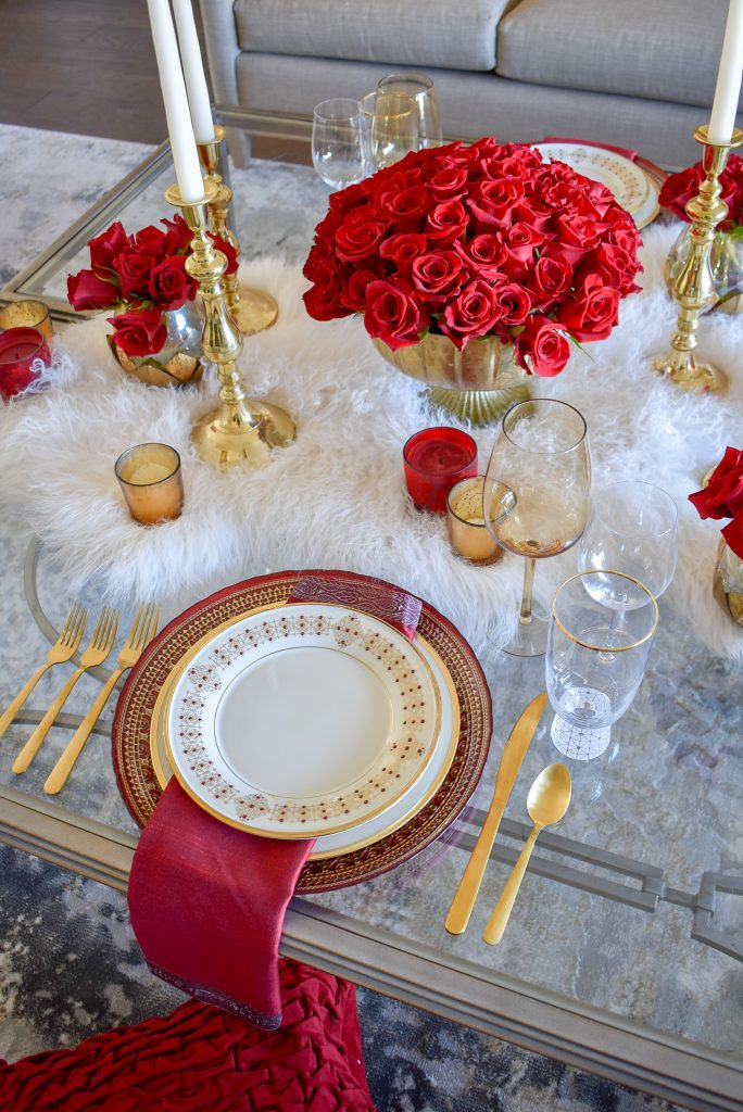 A Romantic Red and Gold Valentine's Day Table for Two on a Mongolian Fur Throw