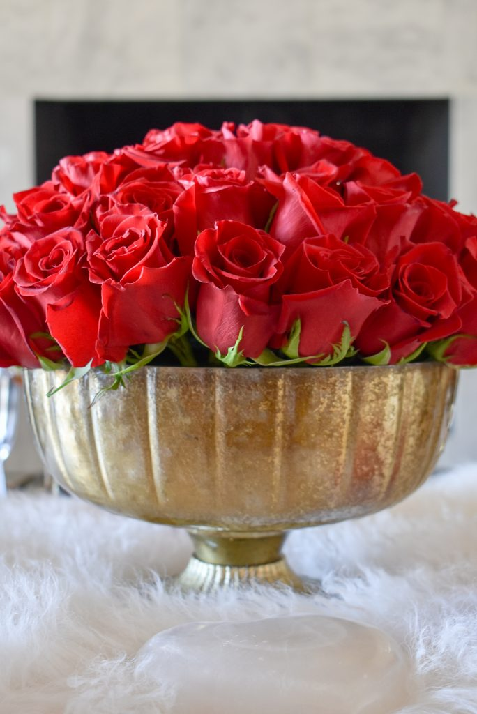 The red roses on a Romantic Red and Gold Valentine's Day Table for Two