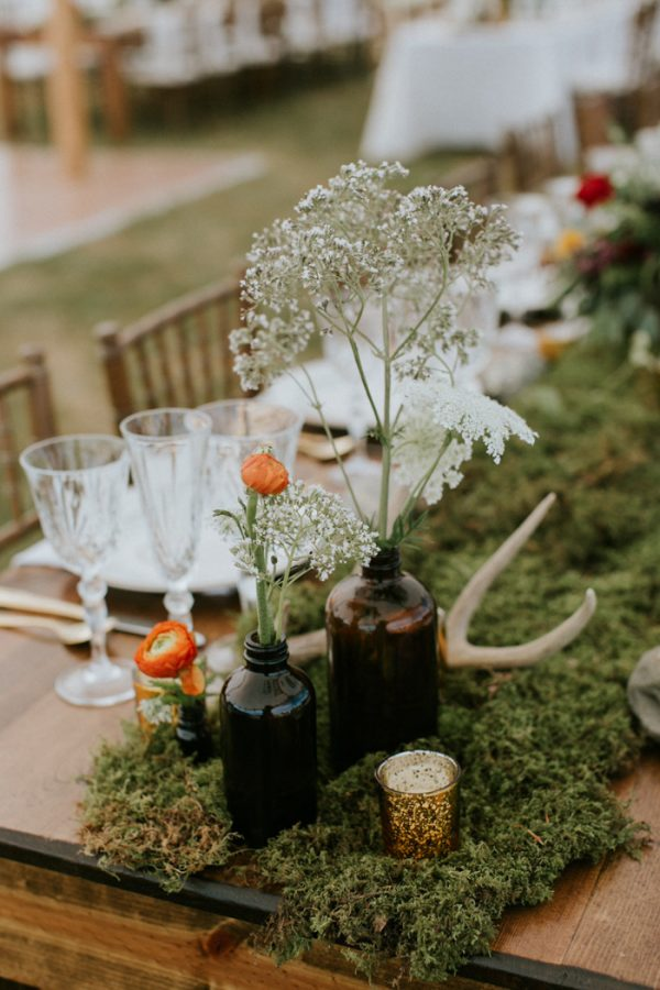 Moss used in a centerpiece on a spring outdoor table setting