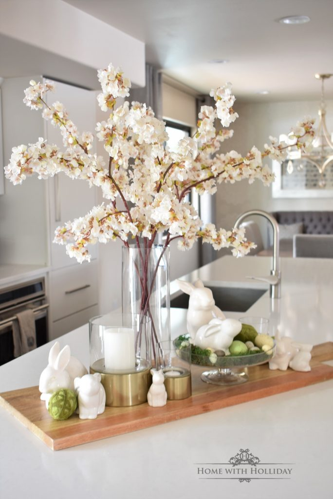 Spring decor on a kitchen island with Cherry Blossoms
