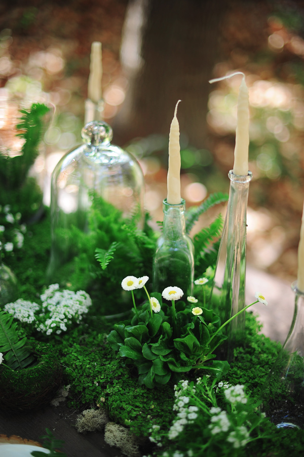 A moss and greenery filled centerpiece for Spring