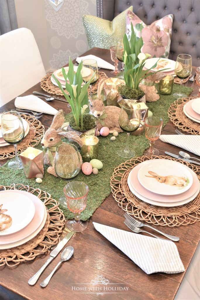 A green and blush pink Easter Tablescape with a moss centerpiece