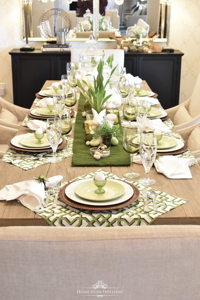 A green and white Easter Tablescape with a moss runner