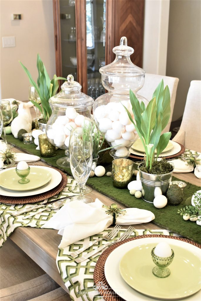 A green and white Easter Table Setting with a moss runner