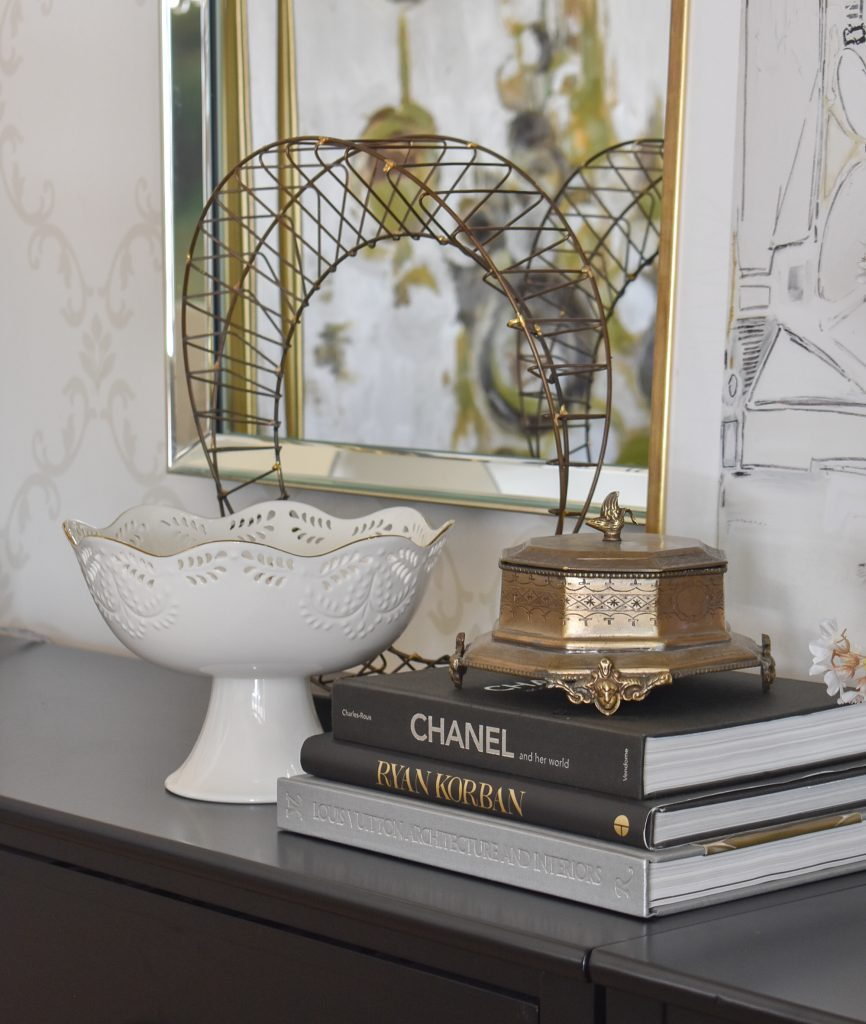 A vignette on a dining room buffet
