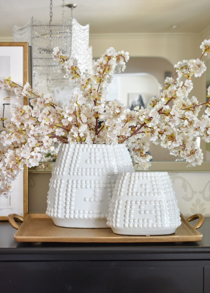 Cherry Blossoms in a white vase on a buffet