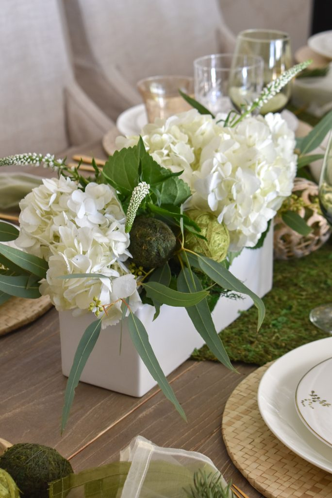 Flowers on a Fresh Green and White Spring Table Setting for Easter