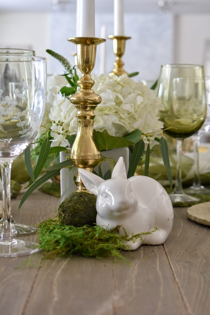 Bunny on a Fresh Green and White Spring Table Setting for Easter