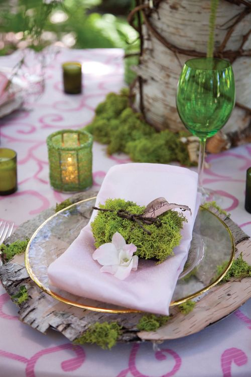 Moss used in a place setting on a spring tablescape