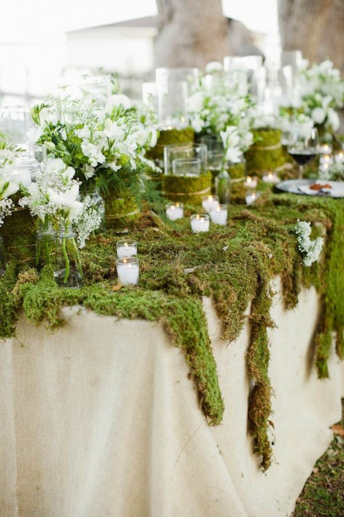 Moss used as the foundation on a wedding table