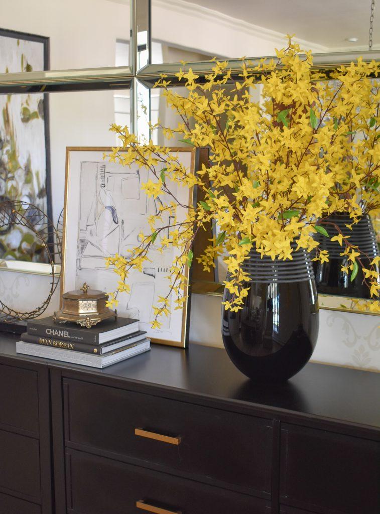 Yellow Forsythia on a black buffet