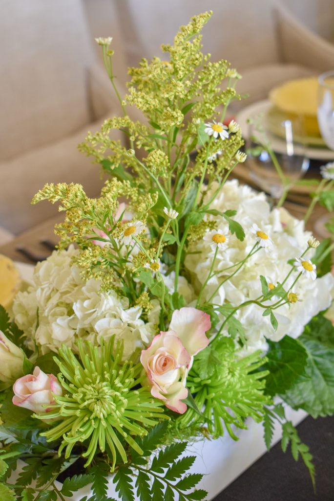 Flower arrangement on a Spring Tablescape with Bold Colors