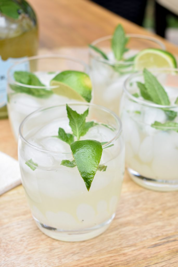 Four Lime and Mint Tequila Spritzers on a tray