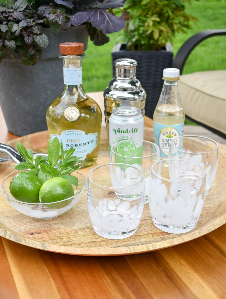 Ingredients for a Lime and Mint Tequila Spritzer on a tray