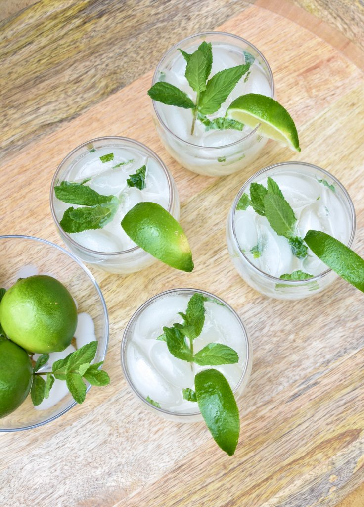 A Refreshing Lime and Mint Tequila Spritzers on a tray