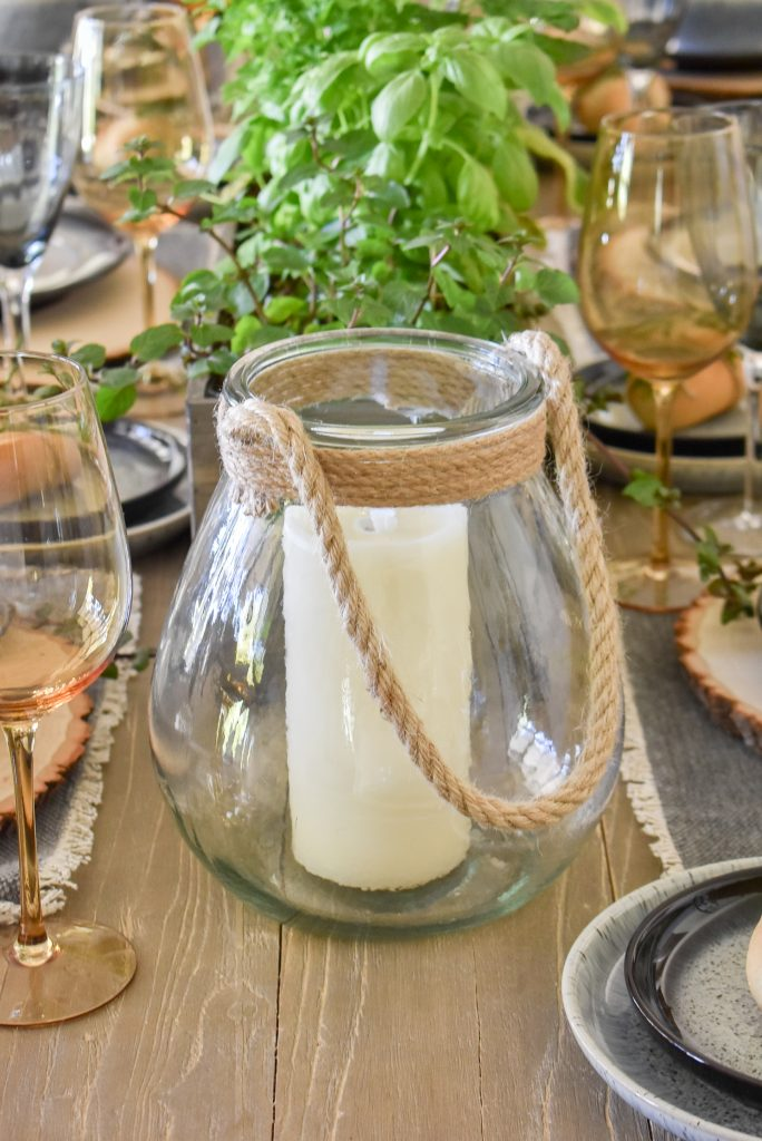 Glass Lantern on a Sophisticated Father's Day Table with Herb Centerpieces