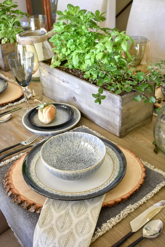A Sophisticated Father's Day Table with Herb Centerpieces and wood chargers