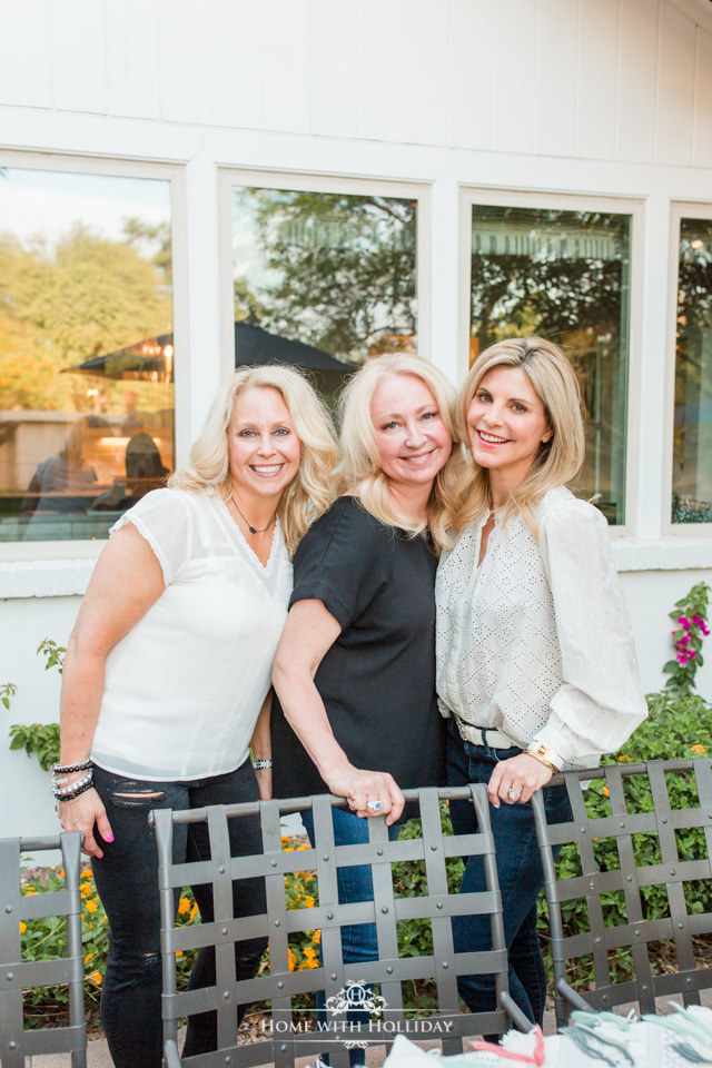 Three bloggers working on an alfresco dining tablescape