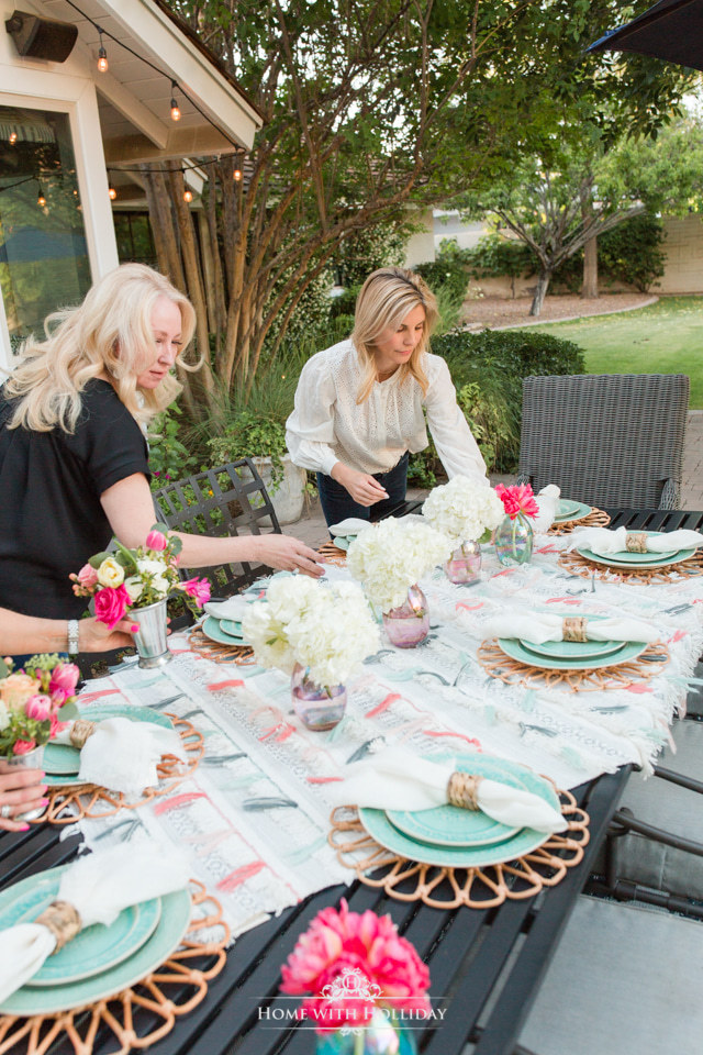 Bloggers working on creating a colorful summer alfresco dining tablescape