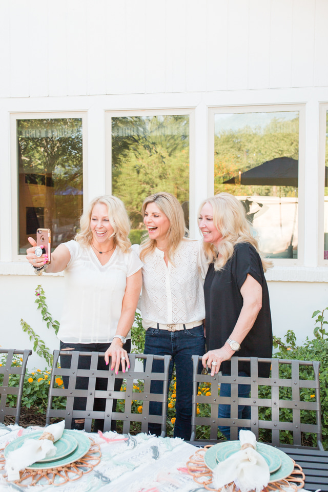 Three bloggers working on a Colorful Summer Alfresco Dining Tablescape