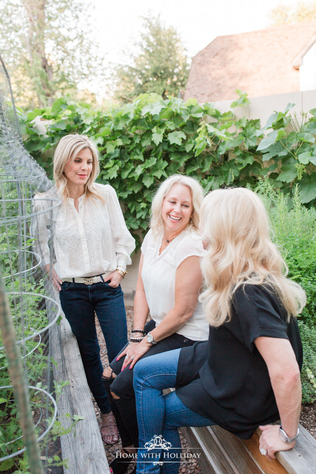 Three bloggers chatting in a garden