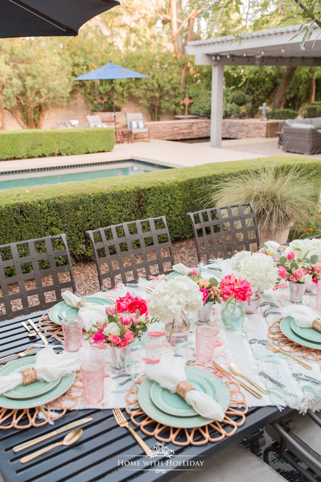 A Colorful Summer Alfresco Dining Tablescape made with a throw blanket