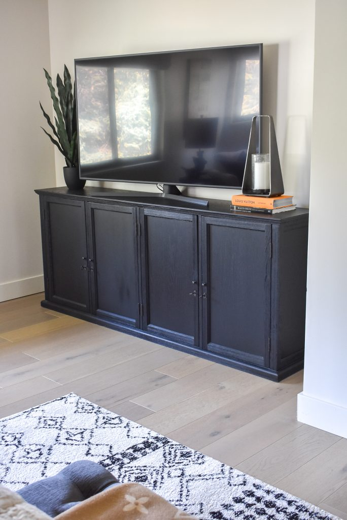 A media console and TV in Our Classic Contemporary Master Bedroom Reveal