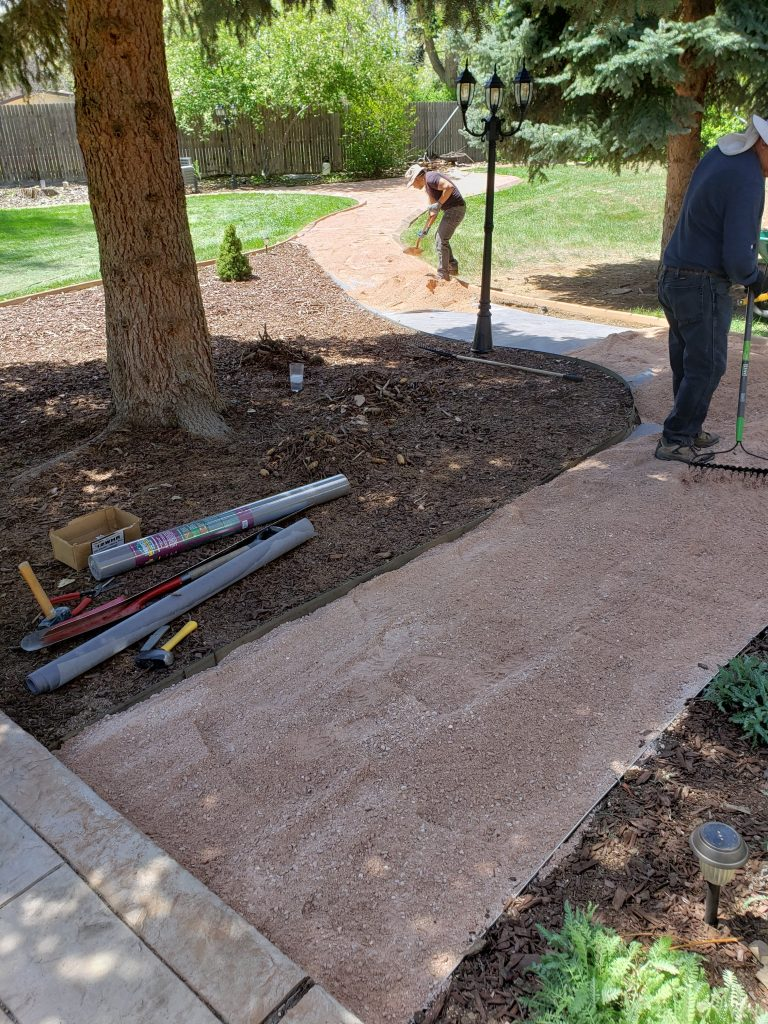 A new pathway being made in a backyard for a new firepit