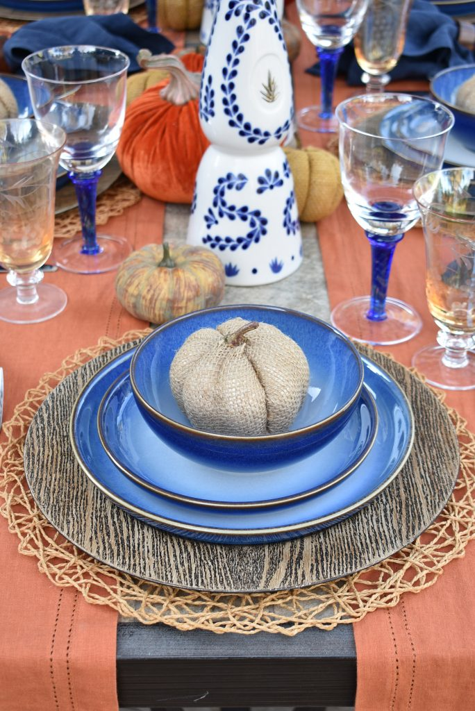 The place settings on Blue and Orange Alfresco Dining Tablescape for Fall