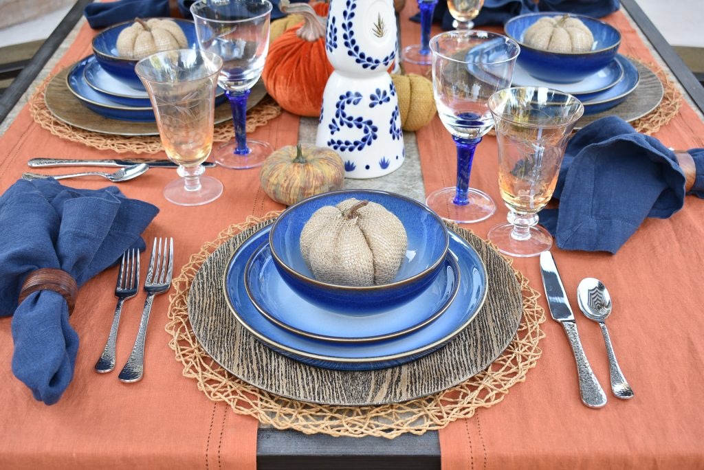 The place setting on a Blue and Orange Alfresco Dining Tablescape for Fall