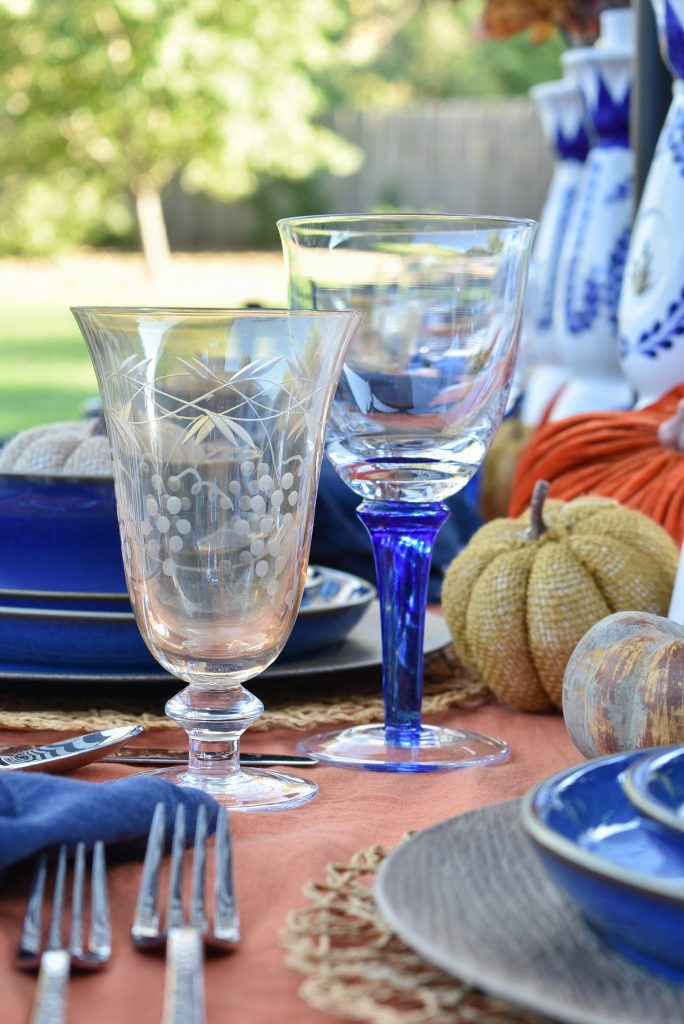 Stemware on a Blue and Orange Alfresco Dining Tablescape for Fall