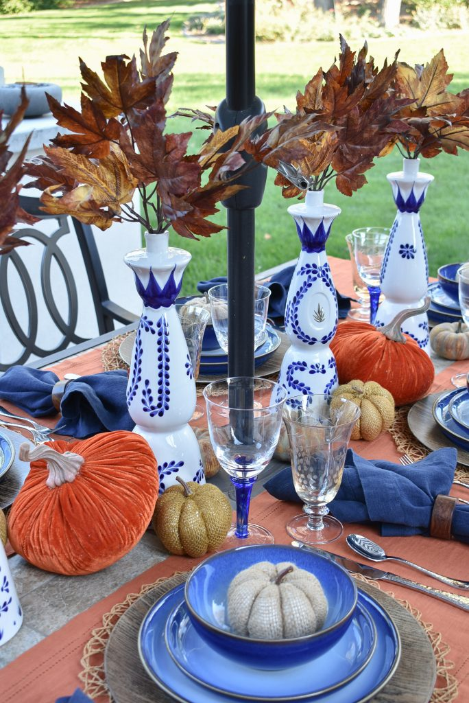 Centerpiece on a Blue and Orange Alfresco Dining Tablescape for Fall