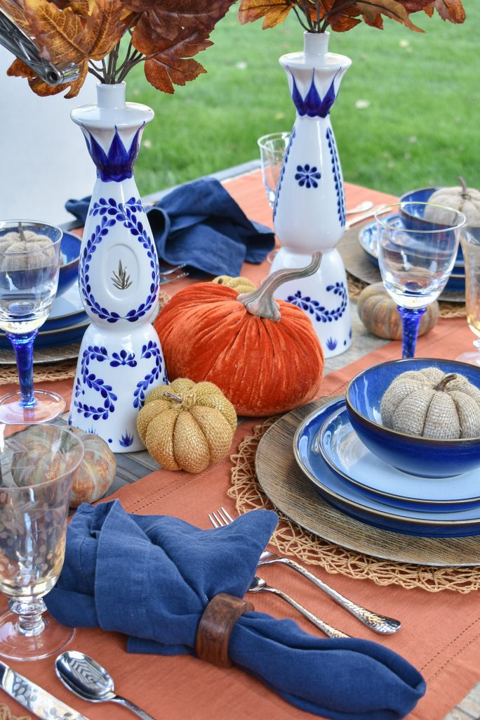 Pumpkins on a Blue and Orange Alfresco Dining Tablescape for Fall