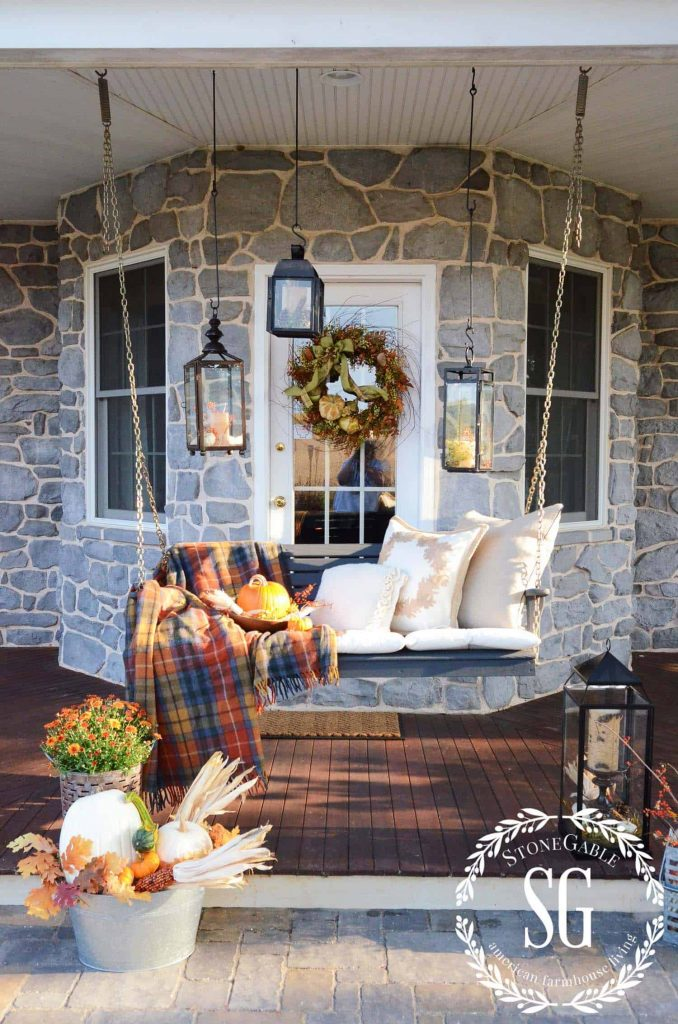 A cozy front porch decorated for fall