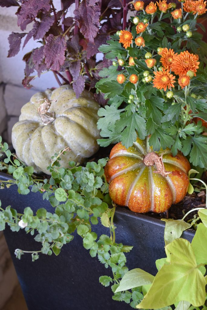 Fall Planter Pots on a front porch decorated for fall with pumpkins